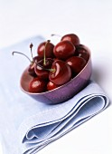 A small dish of cherries (can also represent wine bouquet)