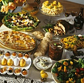 Easter buffet: salads, roast meat, gratin, eggs and cake