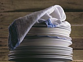 Pile of plates with tea towel