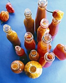 Various chilli sauces in bottles