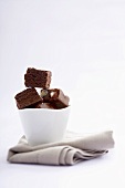 Chocolate fudge in a small bowl