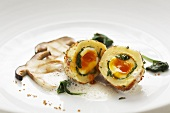 Quail egg dumpling with ceps