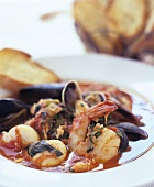 Cioppino (fish stew) with toasted bread