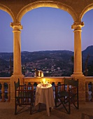 Champagne by candlelight on the veranda of a restaurant