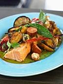 Salmon dish with sausage and potatoes