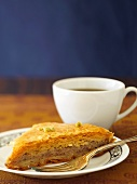 A piece of baklava and a cup of tea