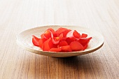 Red rose petals in a dish