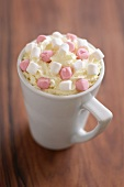 A cup of cappuccino with marshmallows