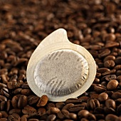 Espresso pod on coffee beans
