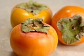 Three Sharon fruits