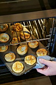 Taking Yorkshire puddings out of the oven
