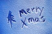 Merry Xmas Schrift auf Eisscheibe
