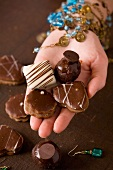 Hand holding Belgian chocolates