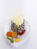 Tonka bean mousse with spun sugar, chocolate lattice & kumquats