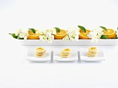 Orange biscuits and oranges with flowers