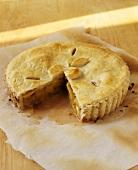 Peach pie, a portion removed