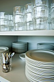 Plates and glasses on kitchen shelves