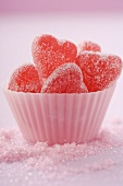 Sugar-coated, red, heart-shaped jelly sweets (close-up)