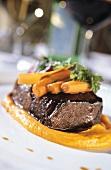 Braised beef on carrot puree
