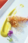Prawn with citrus avocado sauce and grated hazelnuts