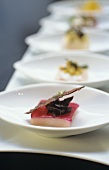 Amberjack with beetroot and slice of bacon