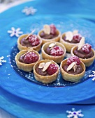 Pastry shells filled with chocolate mousse and raspberries