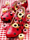 Red shoes with liquorice allsorts