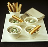Mushroom soup with crème fraîche, chives and bread sticks