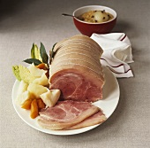 Rolled ham with spicy apple sauce