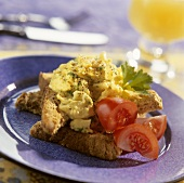 Scrambled egg and tomato on wholemeal bread