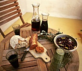 Paprika sausage, bread, olives and red wine