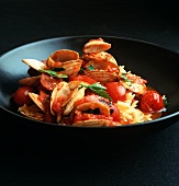 Venus clams with tomato sauce, chorizo and puntalette pasta