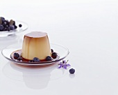 Creme caramel with blueberries
