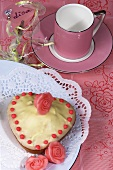 Small heart-shaped cake, marzipan roses, pink cup & saucer