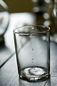Empty water glass (b-w photo)