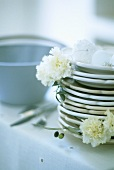 Pile of plates and white decorations (close-up)