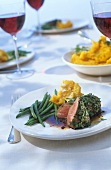 Roast lamb with herbs, French beans and pumpkin puree