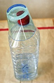 A glass on a plastic water bottle