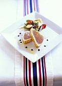 Lightly seared tuna steaks with vegetables