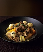 Lamb stew with vegetables and dumplings