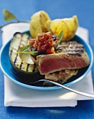 Grilled tuna with avocado and diced tomato