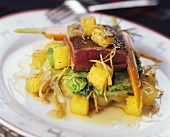 Roast duck breast with pineapple on vegetables
