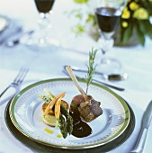 Lamb cutlets with plum sauce and vegetable custard