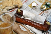 Fast food: sausages, mustard, bread roll, beer, newspaper