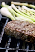 Beef steak on barbecue grill rack