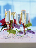 Glasses of sparkling wine with 75th birthday labels