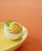 Stuffed egg with curry cream filling