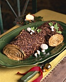 Bûche de Noël (Yule log) with marzipan mushrooms