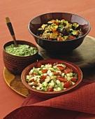 Cucumber salad, aubergine salad and avocado dip