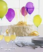 White chocolate cake and balloons